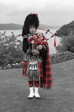 Scottish bagpiper of the highlands Royalty Free Stock Photos