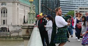Scottish Bagpiper Playing On A Bridge In London stock video footage