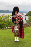 Scottish bagpiper Stock Image