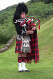 Scottish bagpiper Stock Photos