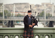 Scottish bagpiper on the Westminster bridge Royalty Free Stock Image