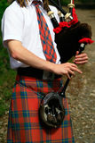 Scottish bagpipes close up. Scottish man in Highland dress playing bagpipes royalty free stock photos