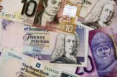 Scottish Banknotes. A wallpaper pattern made from Scottish banknotes.  The notes are for pounds sterling but the notes only tend to be used in Scotland and are Stock Photography