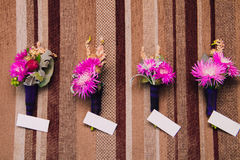 Scottish boutonniere on the wall. Scottish Boutonniere hang on a striped wall and white sheets for text Stock Image