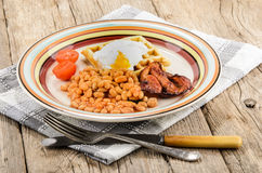 Scottish breakfast with baked beans, fried bacon, tomatoes, waff Stock Image