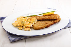 Scottish breakfast with kipper fried with oat bran Royalty Free Stock Photography