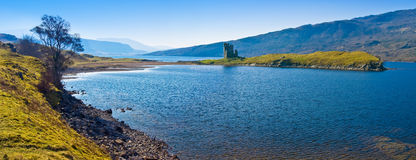 Scottish Castle Ruin. The ruins of Ardvrech castle on a peninsula by the shore of Loch Assynt, north western highlands of Scotland Royalty Free Stock Images