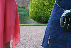 A Scottish Celebration. Men in kilts compete with their partners to show off the best legs Stock Photo