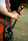 Scottish chanter close up. Scottish man in kilt playing the chanter part of the bagpipes stock photos