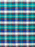 Scottish checkered fabric. Texture of checkered woolen fabric. Scenic woolen plaid with a Scottish pattern Stock Images