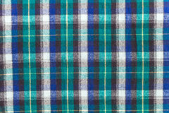 Scottish checkered plaid. Texture of checkered woolen fabric. Scenic woolen plaid with a Scottish pattern Royalty Free Stock Image