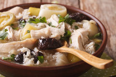Scottish chicken soup with leeks and prunes macro. Horizontal Royalty Free Stock Photos