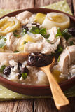 Scottish chicken soup with leeks and prunes macro. vertical Royalty Free Stock Image