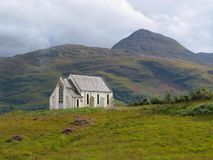 Scottish church in the mountains. A small white church in the highlands of Scotland Royalty Free Stock Photo