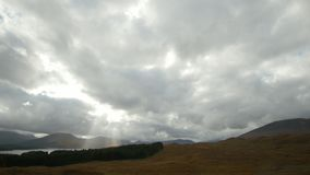 Scottish clouds over highlands - time-lapse, Scotland, UK. Wide angle stock video