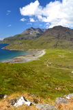 Coastline. Scottish coastline with mountains, ocean, and green valley Stock Image