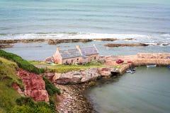 Scottish coastline with very old stone houses Royalty Free Stock Photos