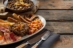 Scottish country breakfast with haggis Stock Photography