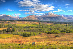 Scottish countryside and snow topped mountains Ben Nevis Scotland UK in colourful HDR Royalty Free Stock Photo