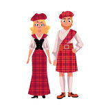 Scottish couple in traditional national costumes, tartan berets and kilts Stock Images