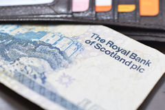 Scottish currency and credit cards in the wallet. Close up Stock Image