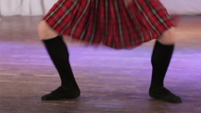 Scottish dancing on stage stock video