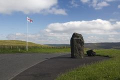 Scottish - English Border, Northumberland, United Kingdom. English flag, rock with England painted on it and information board marking the Scottish - English Royalty Free Stock Photos