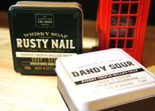 Scottish Fine Soaps. Whisky Cocktail Soaps in a Tin. dandy sour and rusty nail royalty free stock photography