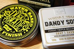 Scottish Fine Soaps. Whisky Cocktail Soaps in a Tin. dandy sour and rusty nail. ducky pomade stock image