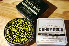 Scottish Fine Soaps. Whisky Cocktail Soaps in a Tin. dandy sour and rusty nail. ducky pomade stock photography