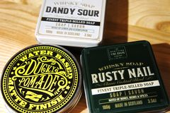 Scottish Fine Soaps. Whisky Cocktail Soaps in a Tin. dandy sour and rusty nail. ducky pomade royalty free stock photo
