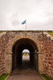Scottish flag flying over the gate to fort george Royalty Free Stock Image