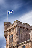 Scottish flag. Image of a scottish flag flying on a building in the town of Callander, Scotland Royalty Free Stock Images
