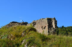 Scottish Flag Over the Ruins of Urquhart Castle in Scotland Royalty Free Stock Photography