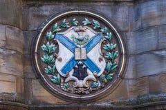 Scottish flag plate on Mercat Cross, Edinburgh, Scotland, UK. Edinburgh, Scotland, UK - June 13, 2012; Closeup of plate set on Metcat Cross near St. Giles stock photos