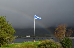 Scottish Flag With a Rainbow royalty free stock images