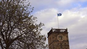 Scottish flag. Saltire flying over the clock tower at Linlithgow Palace stock footage