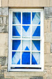 Scottish flag in a traditional white window. Scotland. Stock Image
