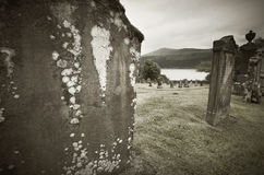 Scottish graveyard and Loch Ness in sepia tone Royalty Free Stock Photography