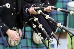 Scottish Highland pipe band. Bagpipe players in traditional kilts in traditional Scottish Highland pipe band Stock Photography