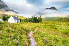 The Scottish Highlands. A remote mountain cottage at the foot of Glencoe in the Scottish Highlands Royalty Free Stock Photo