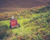 Scottish Hill Farmer. A Hill Farmer On A Quad Bike With Trailer In Rural Scotland Royalty Free Stock Images