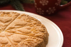 Scottish Holiday Shortbread. Molded Scottish shortbread on a winter/Christmas table setting Royalty Free Stock Image