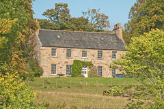 Scottish House in Woodland Royalty Free Stock Photography