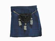Scottish kilt with a black leather sporran. A scottish kilt made of a blue tartan fabric and a black leather sporran isolated on white Stock Photo