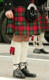 Scottish kilt. Scot in a skirt and leggings Stock Images