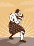 Scottish kilt thrwoing stone put Royalty Free Stock Photography