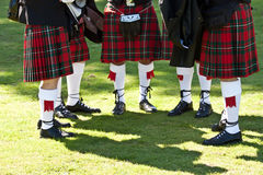 Scottish kilts. Detail of original Scottish kilts, during Highlands games stock photos