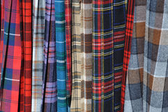 Scottish Kilts. Multiple Colored Scottish Plaid Skirt Kilts for Sale royalty free stock photos