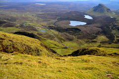 Scottish landscape with mountains, hills, lochs and roads. Landscape of Isle of Skye, Scotland Royalty Free Stock Images